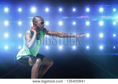 Sportsman practising the shot put against composite image of blue spotlight