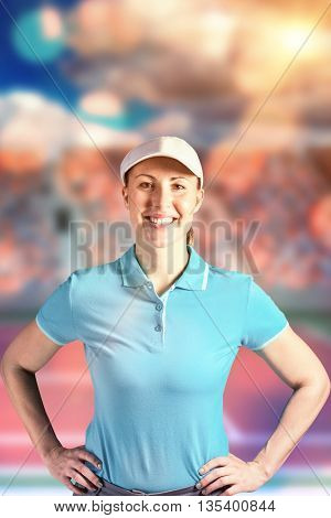 Sportswoman posing on black background against tennis field on a sunny day