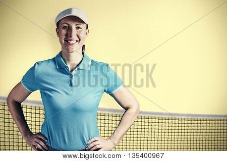 Sportswoman posing on black background against yellow background