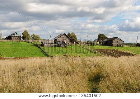 Houses sheds and vegetable gardens in northern russian village sunny autumn day