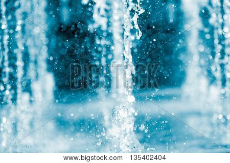 Clean water running from many taps with sparkling drops