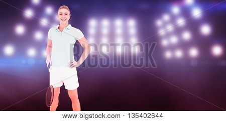 Pretty blonde playing badminton against composite image of spotlight