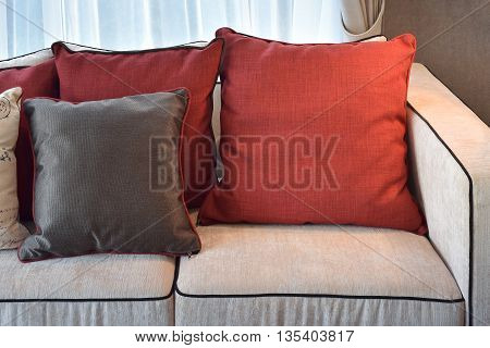 Red And Deep Brown Linin Pillows On Beige Linin Sofa In Modern Classic Living Room