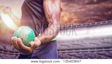 Focus on man holding hammer against composite image of stadium