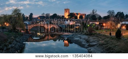 Panoramic night view to Aylesford village in Kent England with medieval bridge and church.