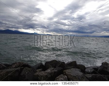 Gloomy autumnal storm lake, mountains in the distance