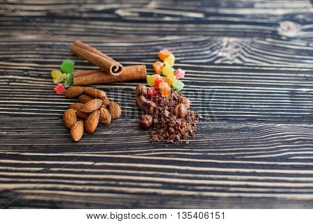Chips of chocolate and nuts on textured board
