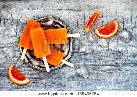 Homemade frozen grapefruit natural juice popsicles - ice pops