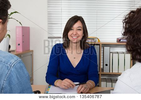 Financial Woman Consultant Presents Bank Investments To A Couple
