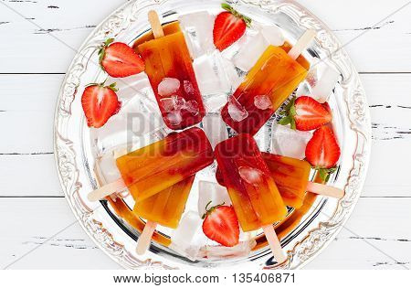 Strawberry mango popsicles - ice pops - paletas on vintage silver tray