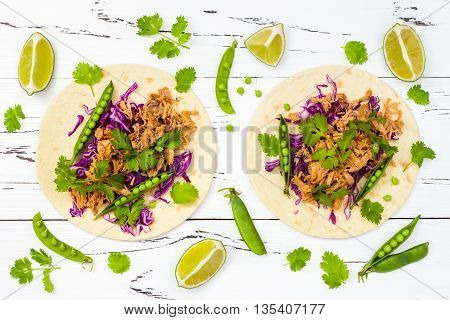 Mexican tacos with meat peas and purple cabbage