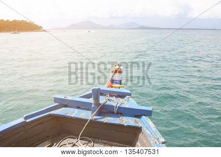Thai boat with sunrise, Blue boat in the sea