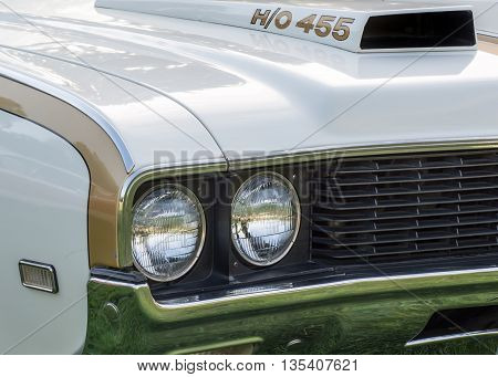 GROSSE POINTE SHORES MI/USA - JUNE 19 2016: A 1969 Oldsmobile Cutlass H/O (Hurst/Olds) car at the EyesOn Design car show, held at the Edsel and Eleanor Ford House, near Detroit, Michigan.