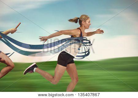 Female athlete running om landscape background