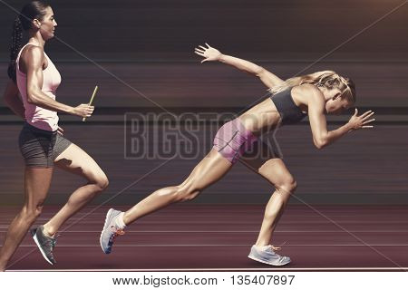 Sporty woman running on a track