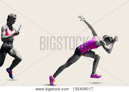 Athletic woman preparing to run against grey background