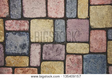 paving stone background. Sidewalk multicolored abstract texture