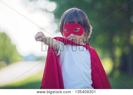 Sweet Little Preschool Boy, Playing Superhero In The Park