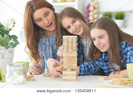 happy Family at the table playing board game