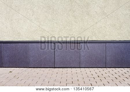 Modern yellow plaster and tiles street wall background