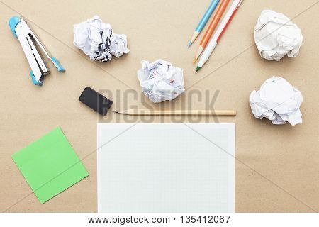 Business concept:white blank paper,crumpled paper and color pencil,pencil,pen on brown paper background