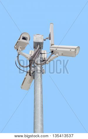 Group of security cameras (CCTV) or surveillance camera on pole isolated on blue background.
