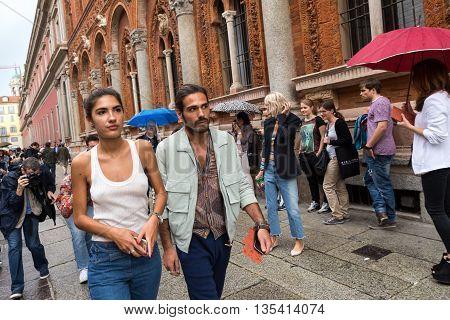 MILAN ITALY - JUNE 19: Fashionable people gather outside Missoni fashion show building during Milan Men's Fashion Week on JUNE 19 2016 in Milan.