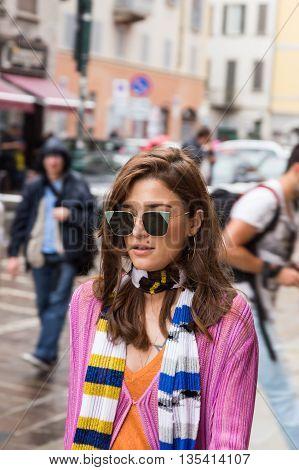 MILAN ITALY - JUNE 19: Fashionable woman poses outside Missoni fashion show building during Milan Men's Fashion Week on JUNE 19 2016 in Milan.