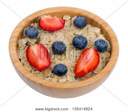 Porridge with strawberry and blueberry. Healthy breakfast isolated on a white background