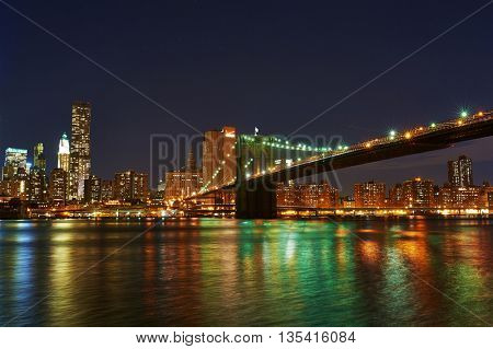 NEW YORK CITY - APRIL 2: Brooklyn Bridge with lower Manhattan skyline in New York City at night, USA,  April 2 2014 in New York, USA