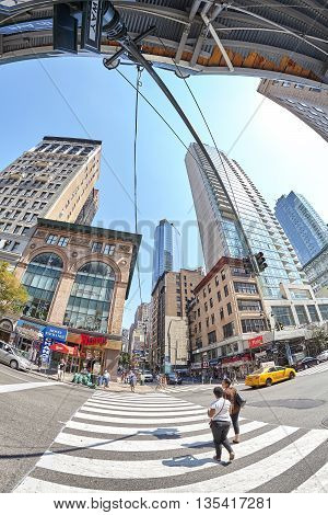 New York USA - August 15 2015: Fisheye lens picture of pedestrian crossing at busy Fifth Ave and East 33rd St corner.