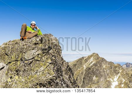 Talking By Phone On Top Of The Mountains.