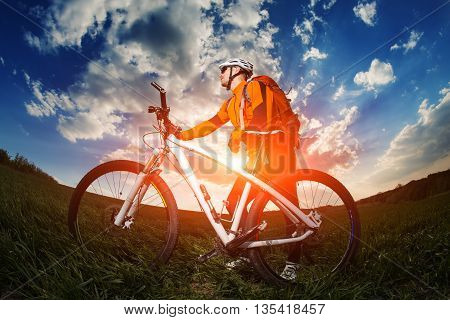 Wide angle view of a cyclist riding a bike on a nature trail in the mountains. healthy lifestyle concept