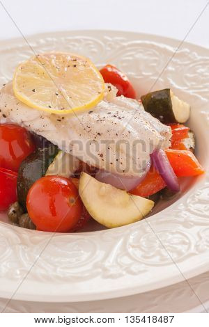 Fish Provencal a mediterranean seafood dish of roasted vegetables and white fish fillet