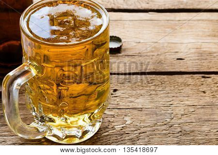 Light Beer Mug And An Empty Bottle Closeup