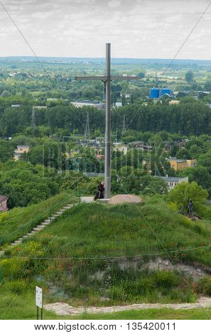 Chelm Poland - June 12 2016: The cross on the way of the cross in a park next to the shrine of the Virgin Mary in Chelm in eastern Poland