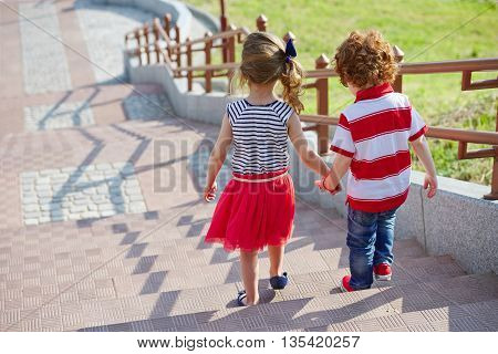 boy and girl walking on the stairway