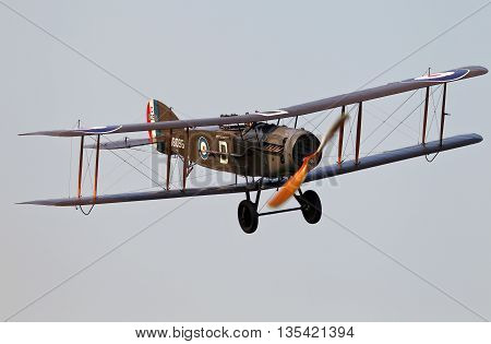 NORTHILL, UK - JULY 6: A vintage Bristol F2b fighter bomber from WW1 gives an aerial display to the watching public at an airshow over Old Warden aerodrome on July 6, 2013 in Northill