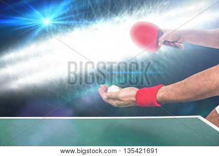 Athlete man playing table tennis against spotlights