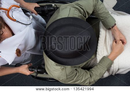 Old Man In Wheelchair With Doctor In Hospital Flat Lay