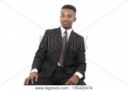 businessman suit and tie seated on white background