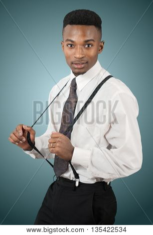 african businessman wearing suspenders on gray background