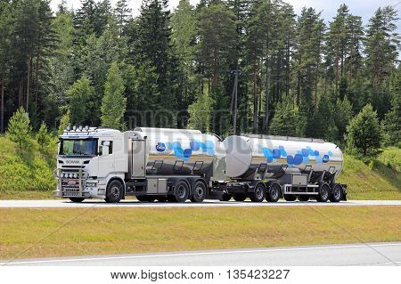 SALO, FINLAND - JUNE 19, 2016: Scania R500 Euro 6 tank truck transports Valio milk along motorway at summer in South of Finland. The usual temperature of transported milk is 3 degrees Celsius.