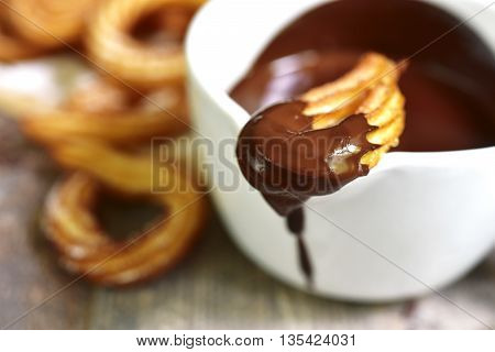 Traditional mexican dessert churros with chocolate sauce.