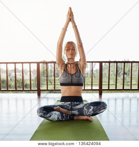 Fitness Female Model Doing Yoga