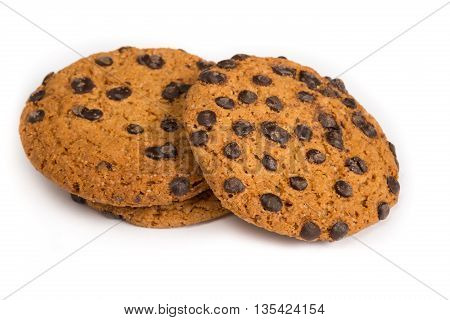 Baked oatmeal cookies with chocolate crumbs on a white background