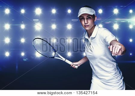 Female athlete playing tennis against composite image of blue spotlight