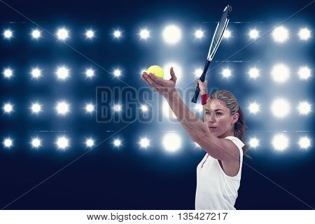 Athlete holding a tennis racquet ready to serve against digitally generated image of blue spotlight