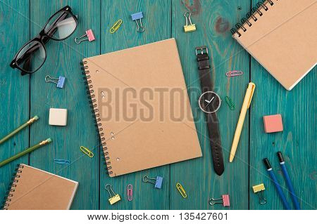 Workplace With Notepad, Glasses, Watch And Other Office Supply On A Desk
