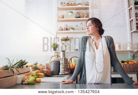Attractive Young Woman Standing Behind The Counter